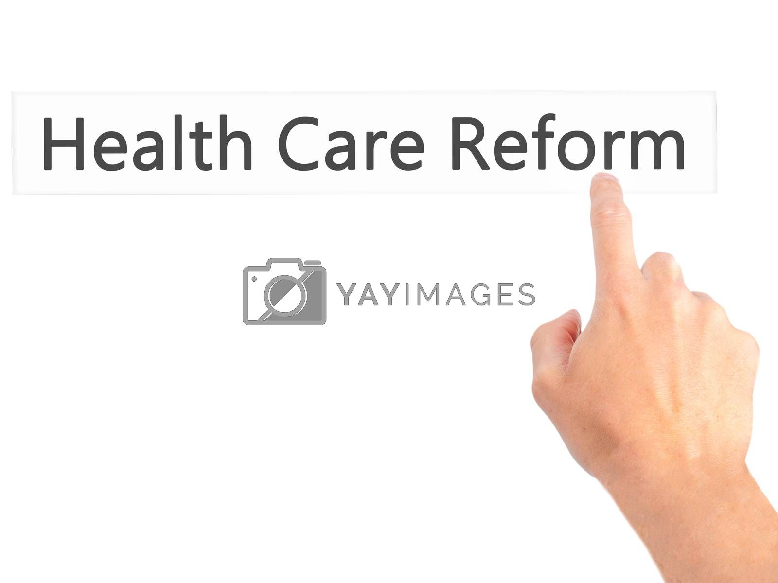 Health Care Reform - Hand pressing a button on blurred backgroun by jackald