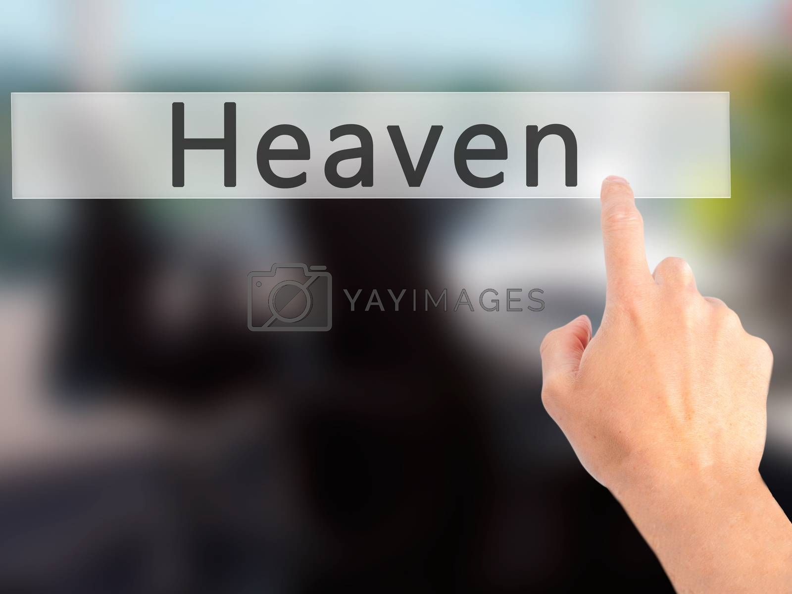 Heaven - Hand pressing a button on blurred background concept on by netsay.net