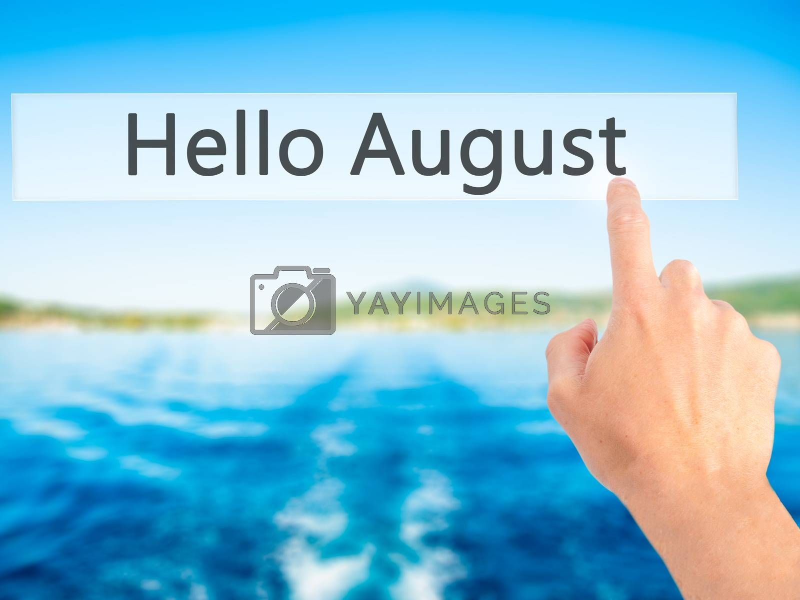 Hello August - Hand pressing a button on blurred background conc by jackald