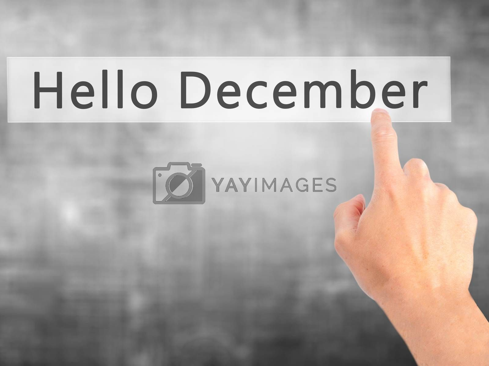 Hello December - Hand pressing a button on blurred background co by jackald