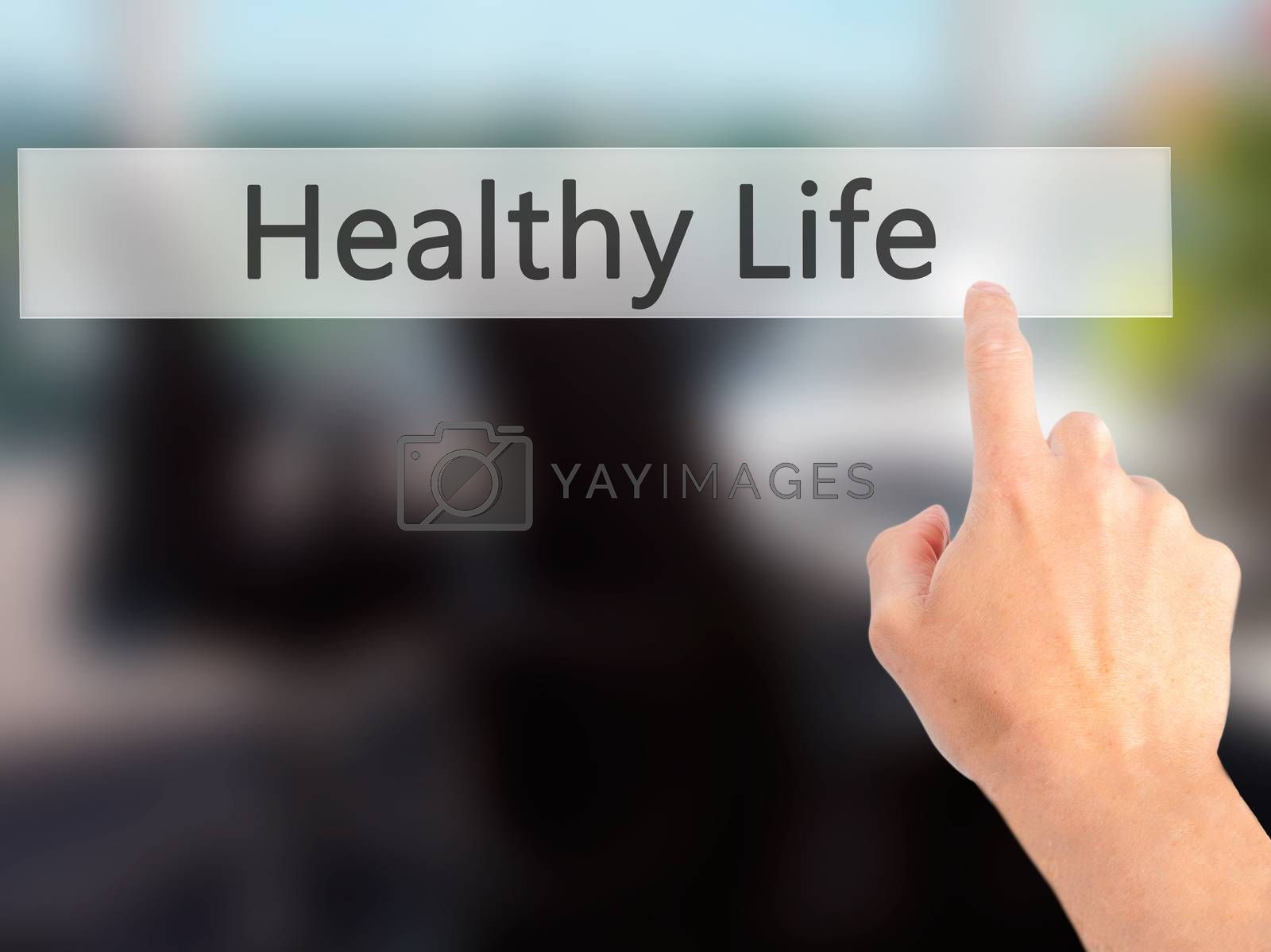 Healthy Life - Hand pressing a button on blurred background conc by jackald