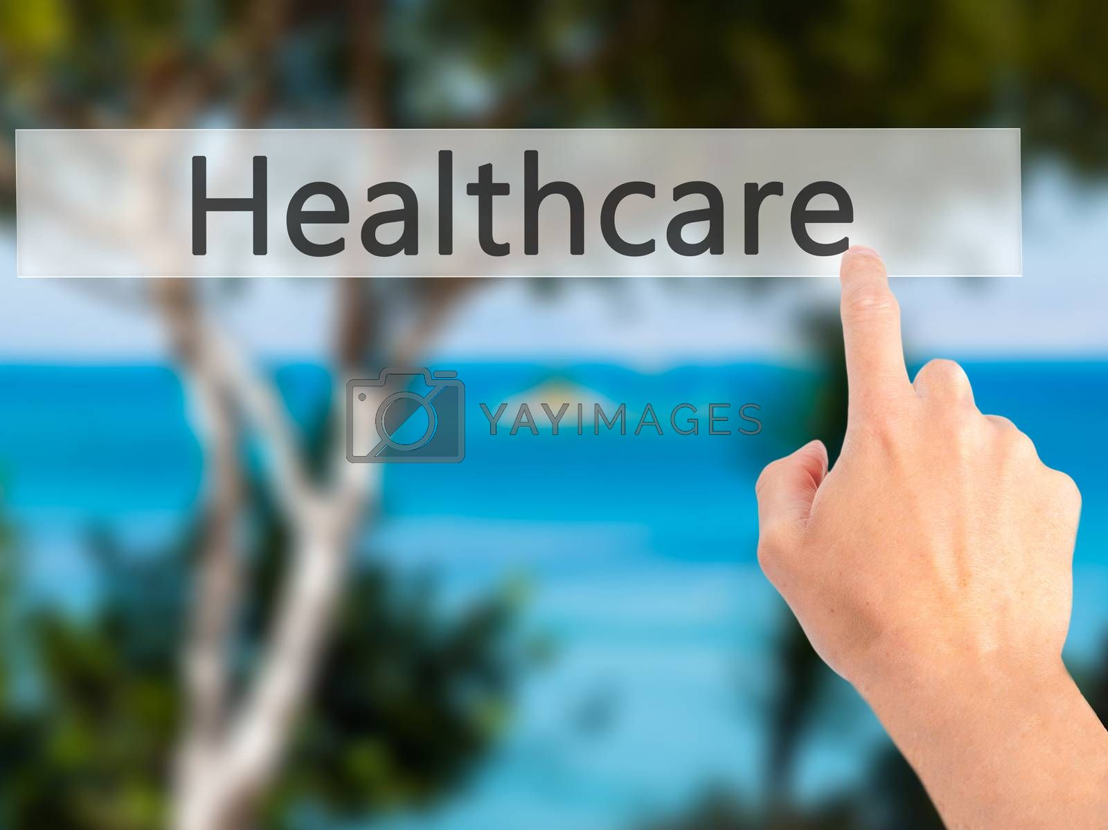 Healthcare - Hand pressing a button on blurred background concep by jackald