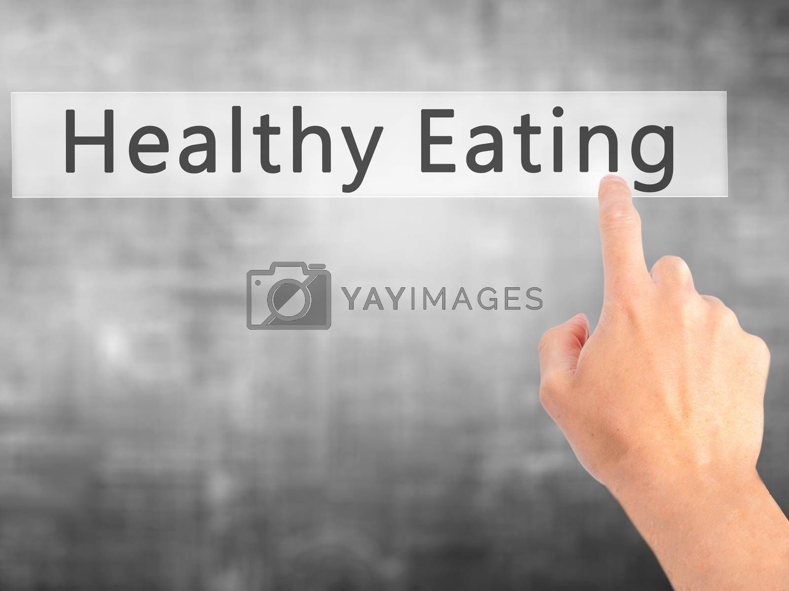 Healthy Eating - Hand pressing a button on blurred background co by netsay.net