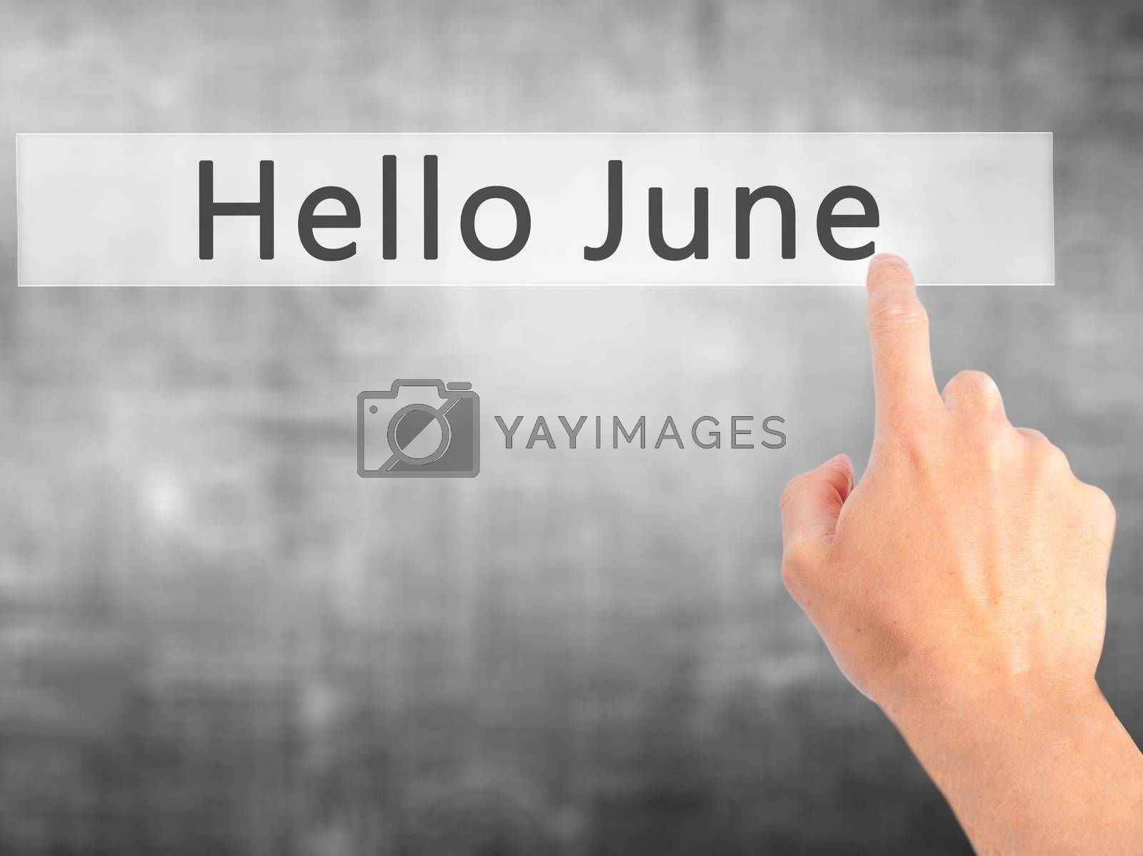 Hello June - Hand pressing a button on blurred background concep by netsay.net