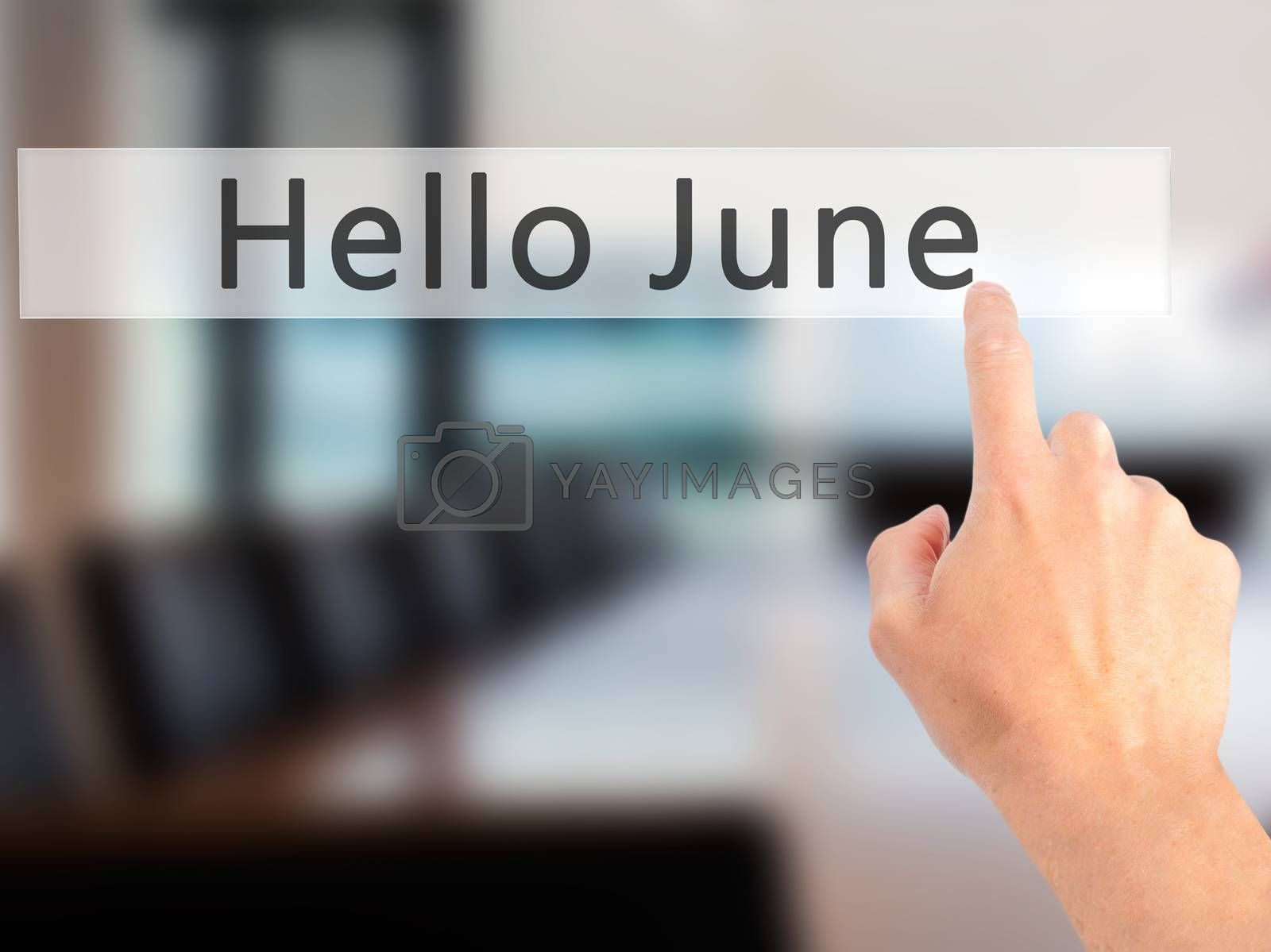 Hello June - Hand pressing a button on blurred background concep by jackald