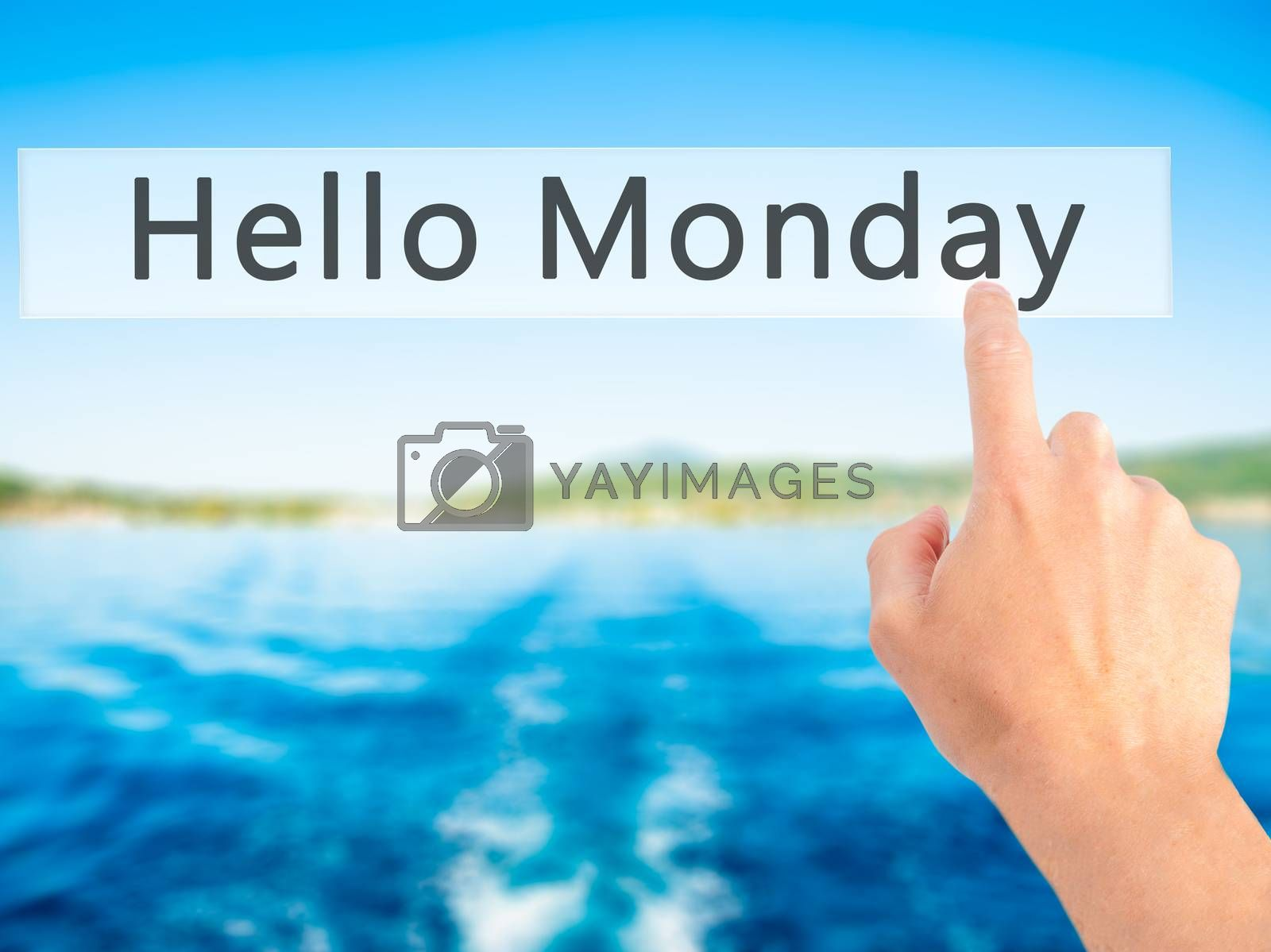 Hello Monday - Hand pressing a button on blurred background conc by jackald