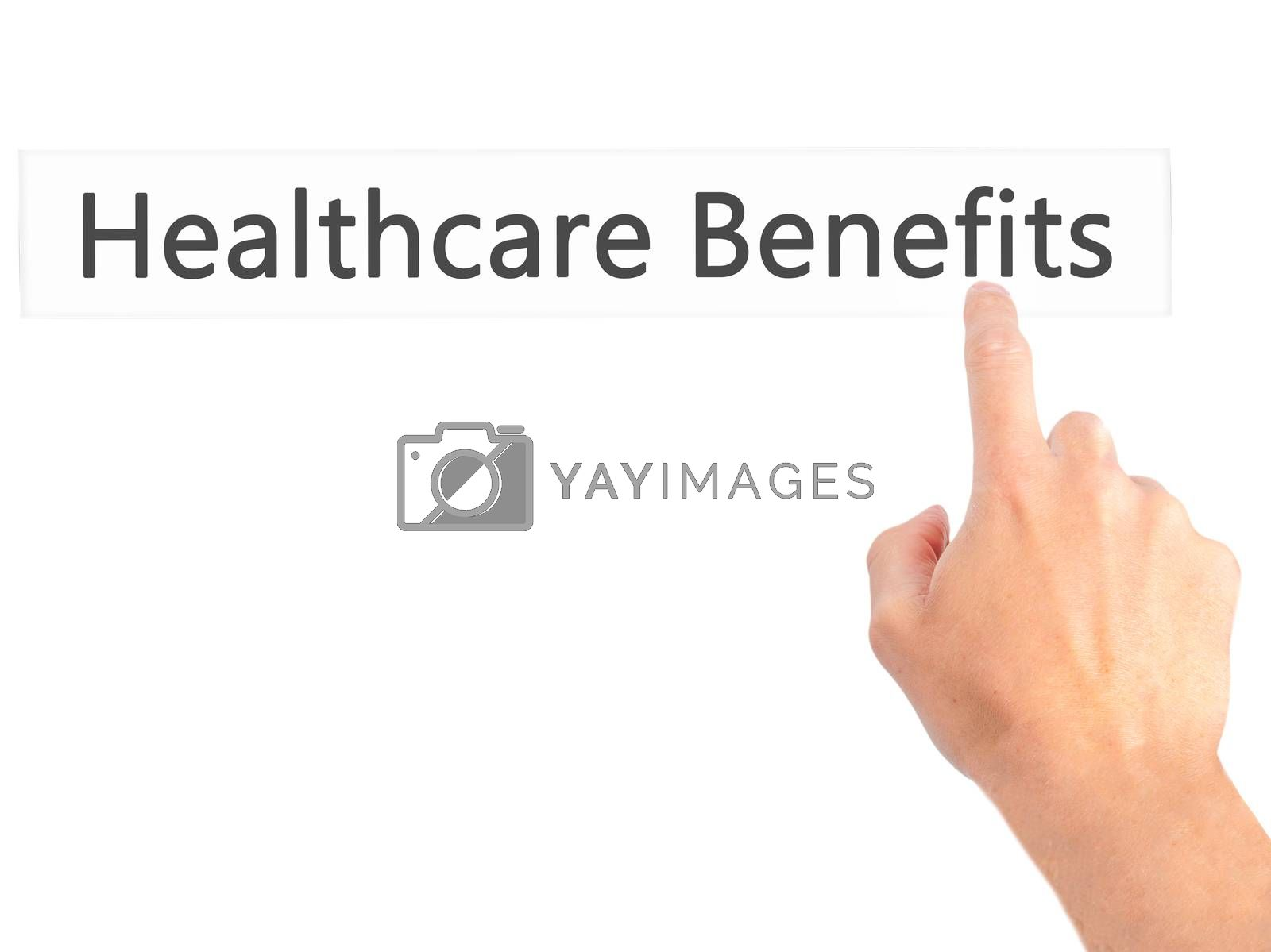 Healthcare Benefits - Hand pressing a button on blurred backgrou by netsay.net