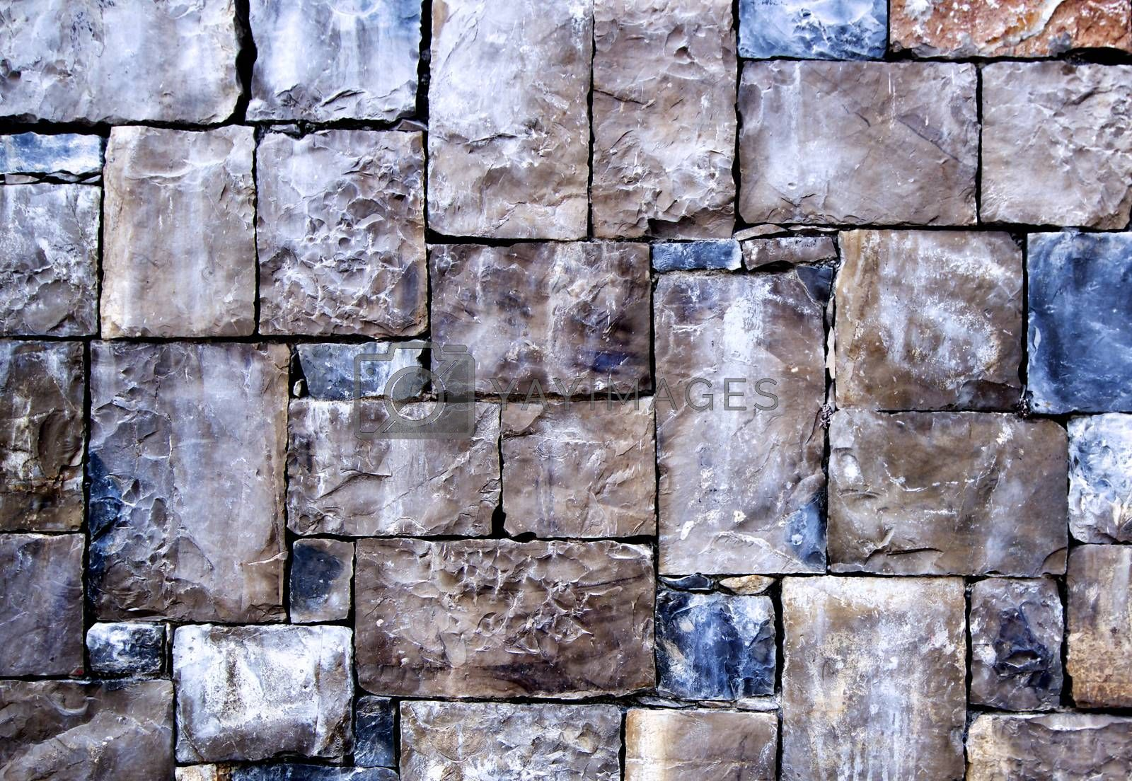 Background of Multi-Colored Cobblestones with Sharp Spears closeup Outdoors