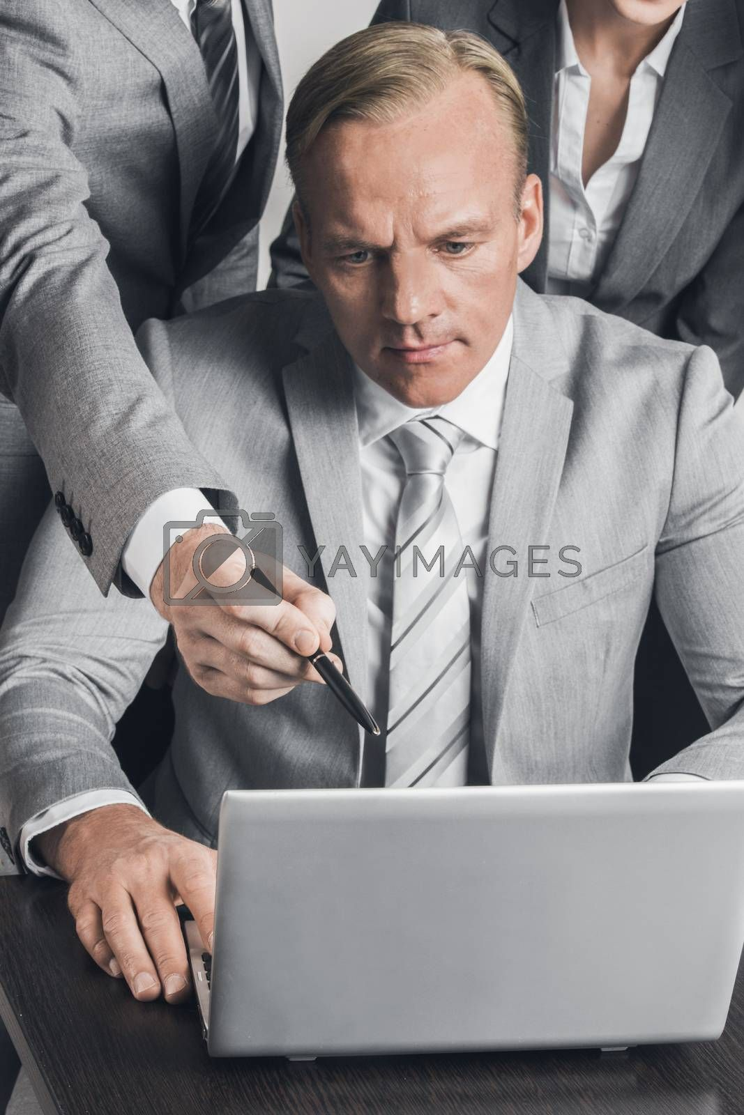Group of business people working together with laptop at meeting