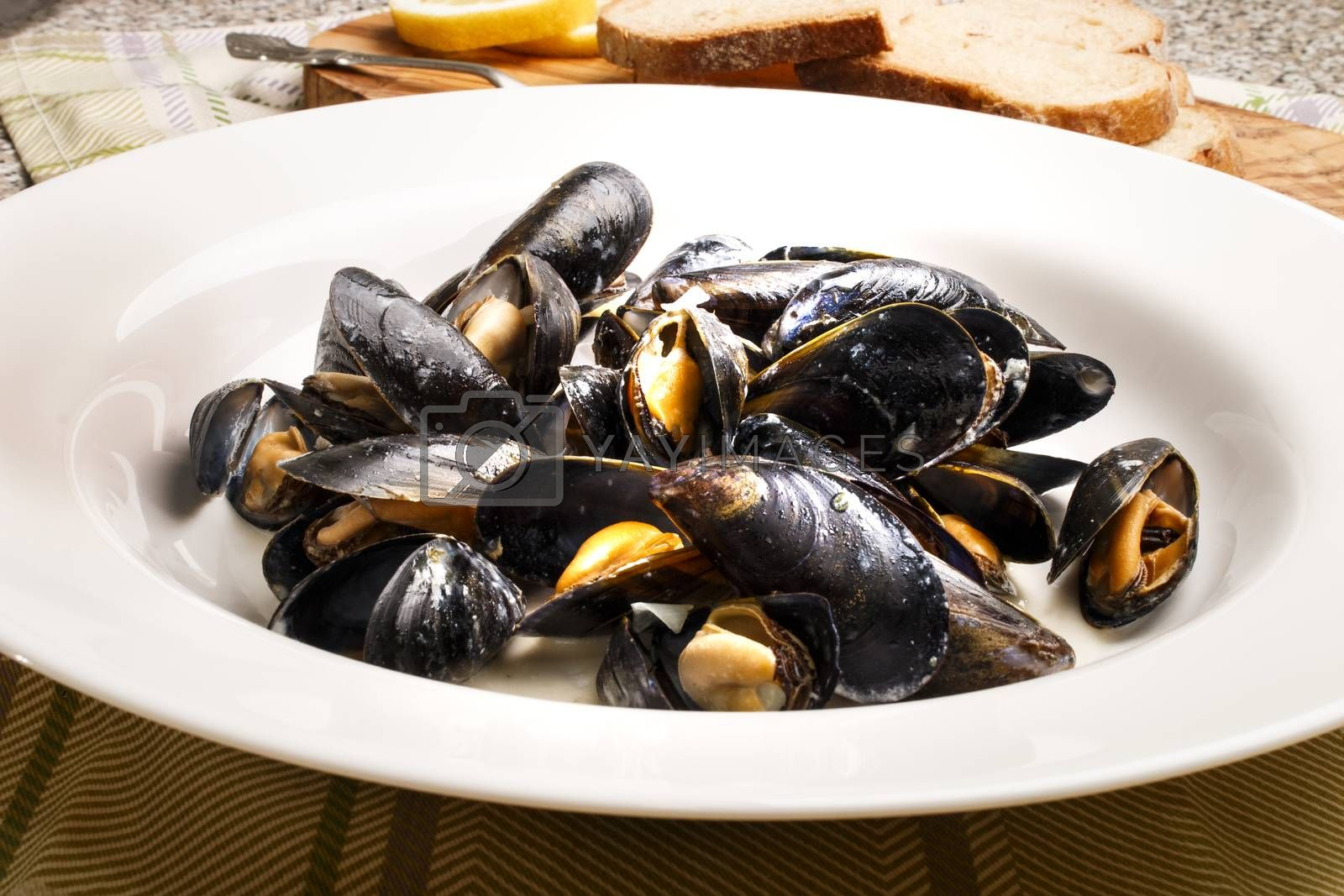 mussels with garlic sauce in a deep white plate