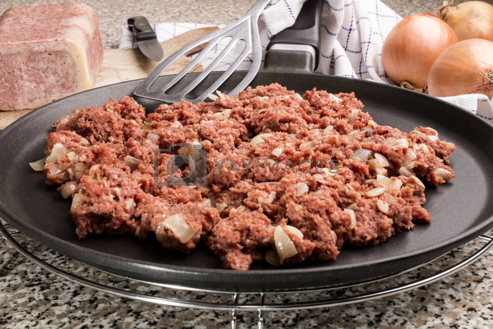 corned beef and white onion on a pan