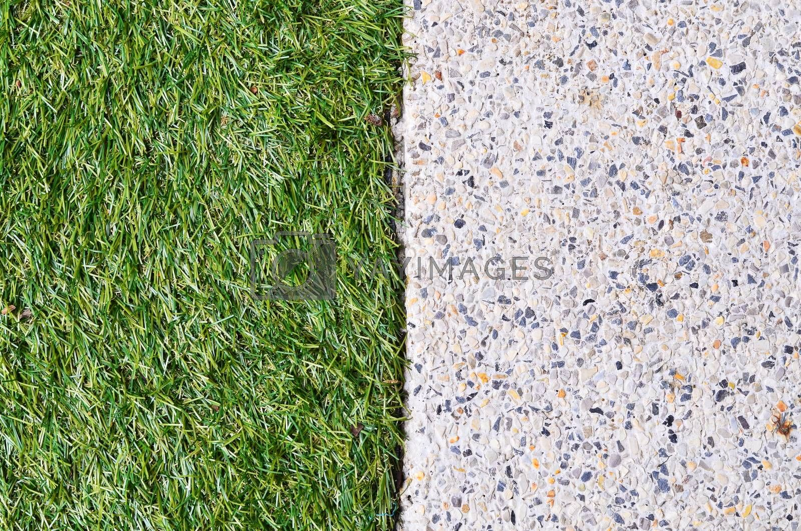 Gravel texture and strip grass as background copy space