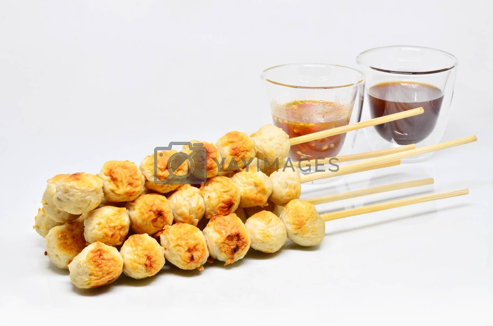 Meatball with thai spicy sauce isolated on white background