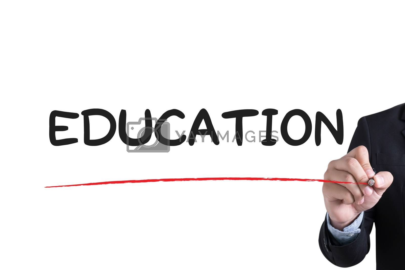 EDUCATION Businessman hand writing with black marker on white background