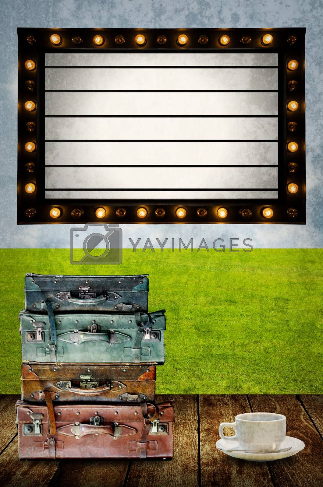 Vintage Light box program board with travel bag and coffee at green meadow garden
