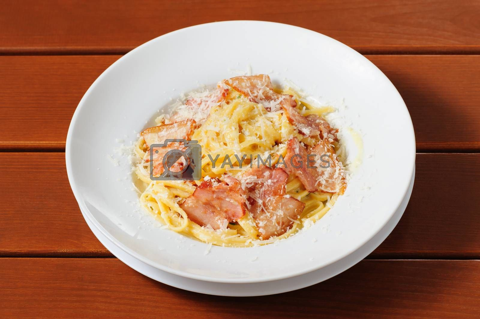 top view tagliatelli carbanara italian cuisine on plate rustic kitchen table background