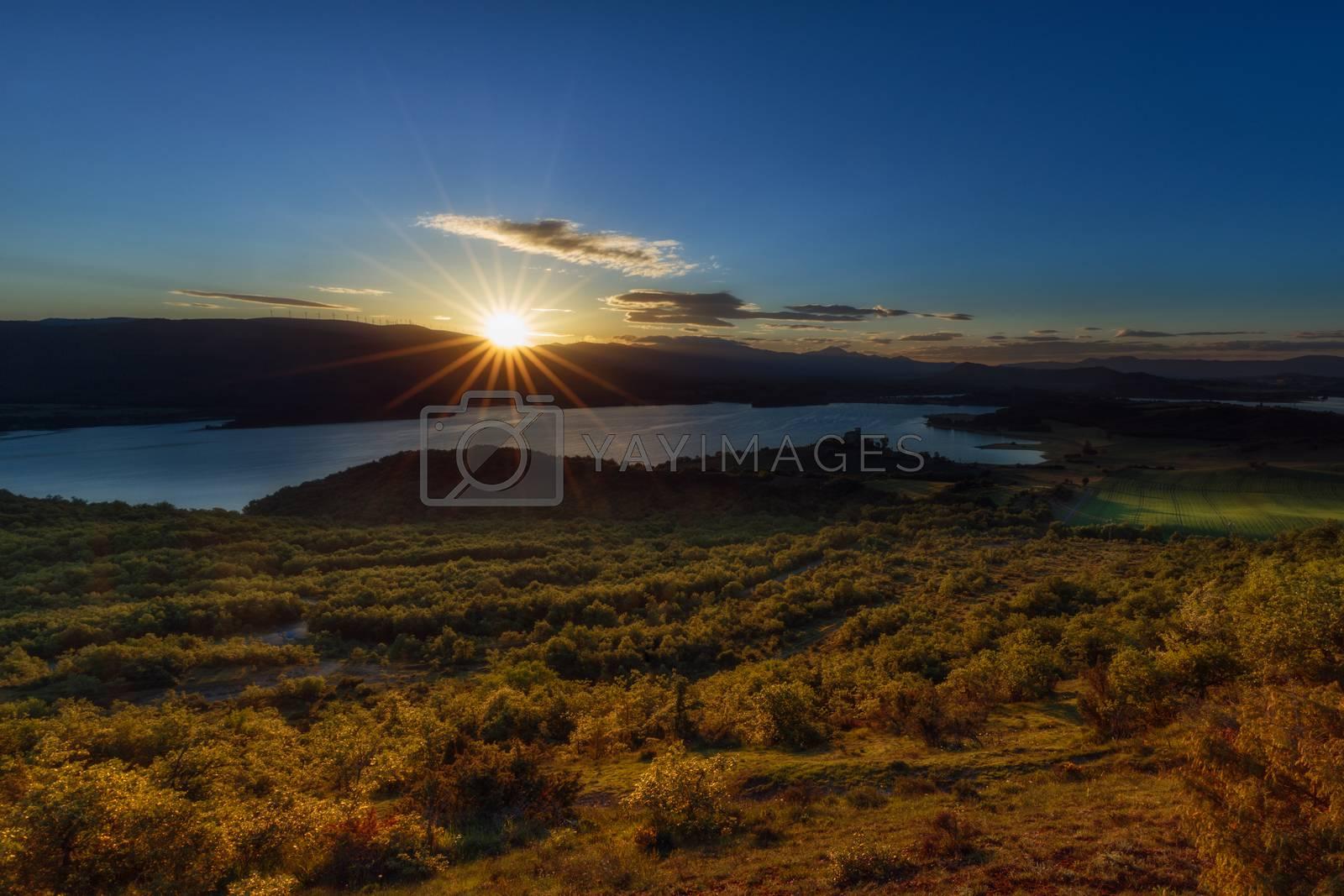 Sun rays over the lake