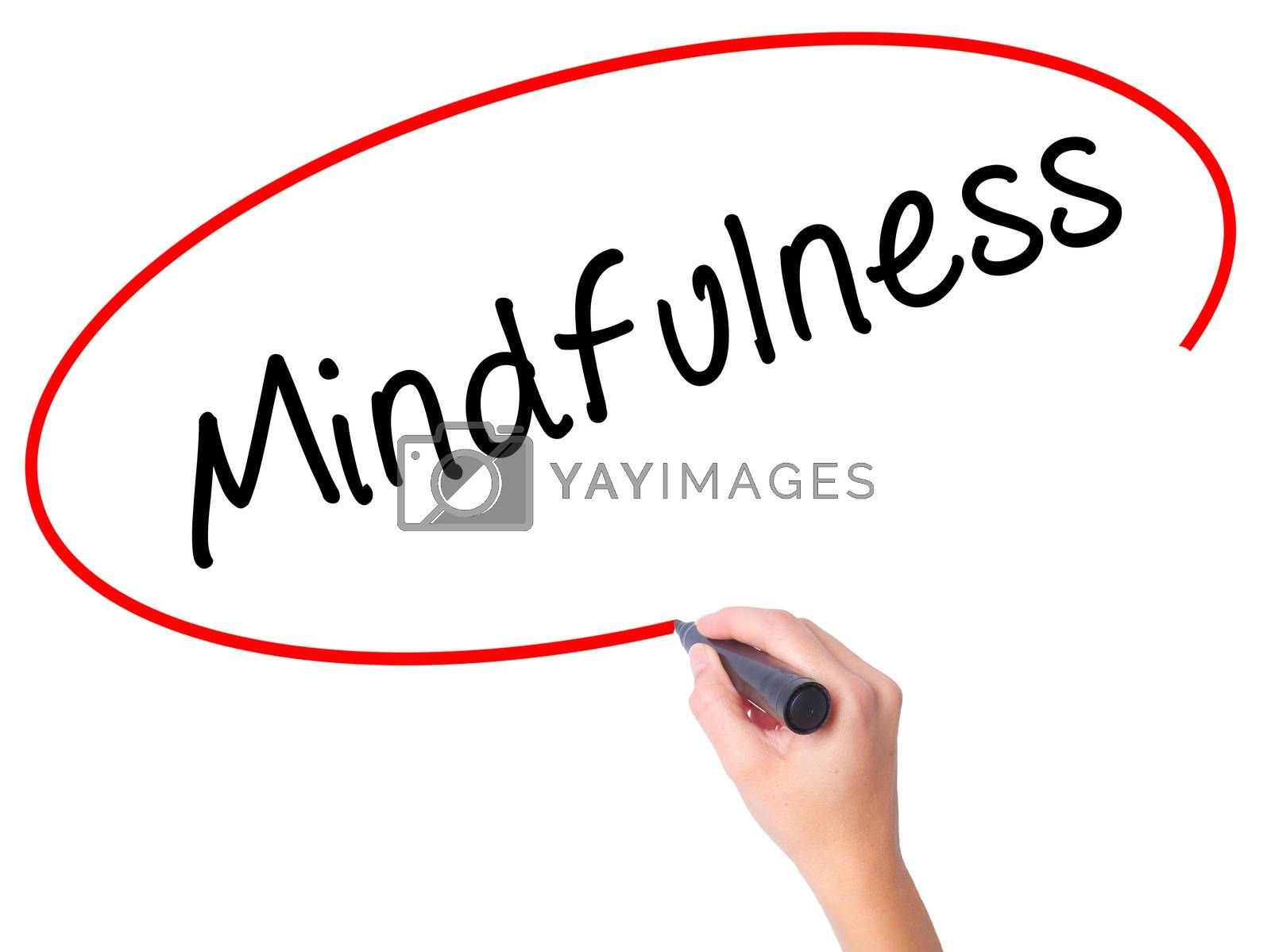 Women Hand writing Mindfulness  with black marker on visual screen. Isolated on white. Business, technology, internet concept. Stock Image
