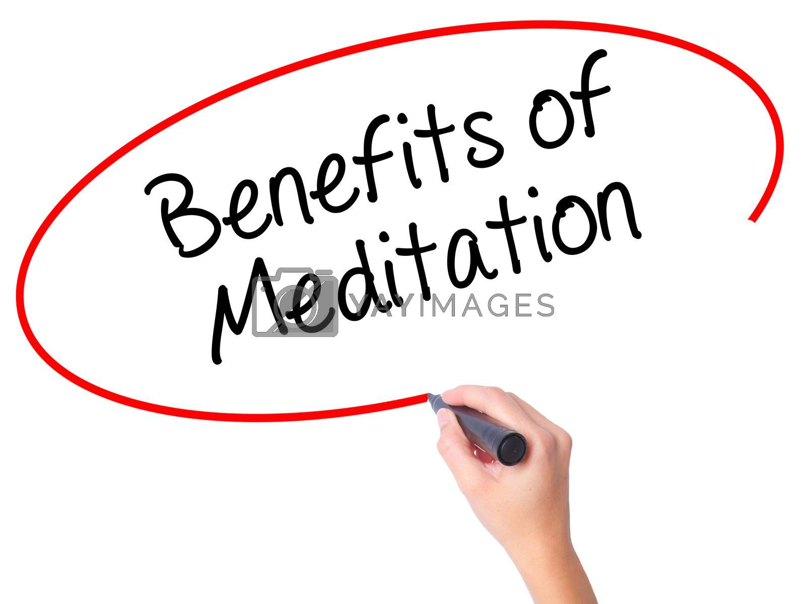 Women Hand writing Benefits of Meditation with black marker on visual screen. Isolated on white. Business, technology, internet concept. Stock Photo