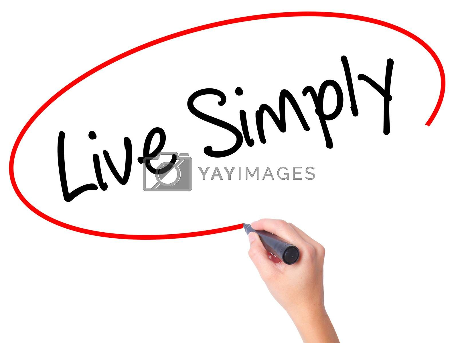 Women Hand writing Live Simply with black marker on visual screen. Isolated on white. Business, technology, internet concept. Stock Photo