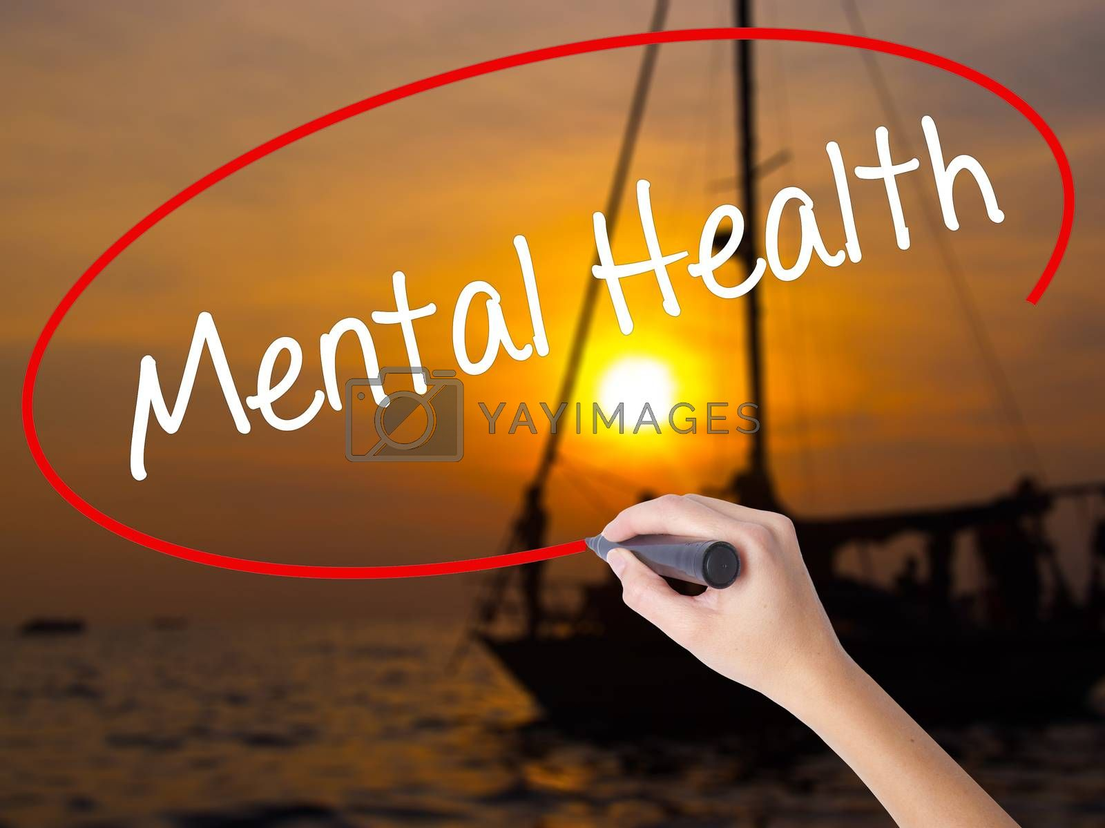 Woman Hand Writing Mental Health with a marker over transparent board. Isolated on Sunset Boat. Business concept. Stock Photo