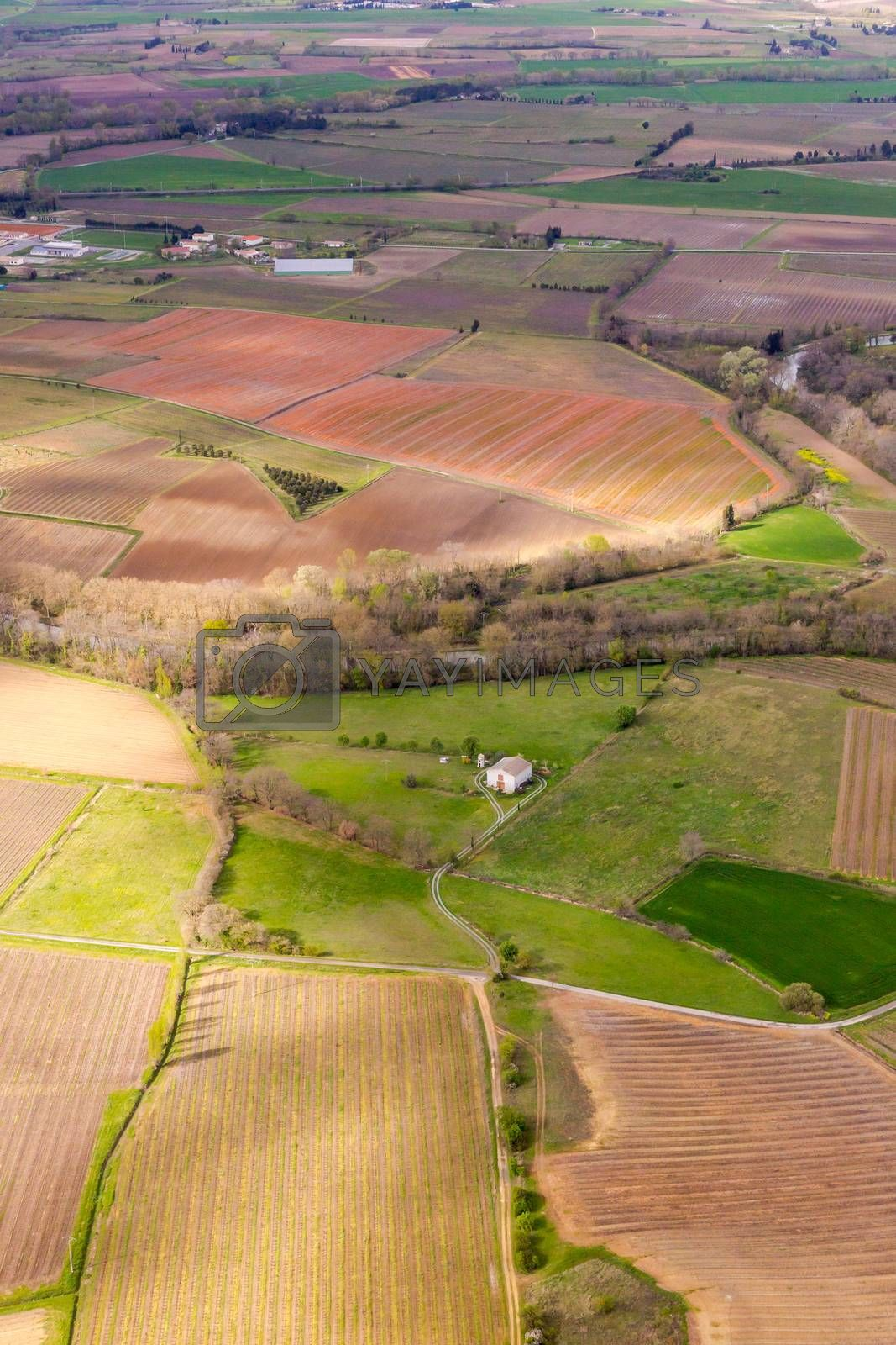 Aerial view from top on green irregular fields on south part of  by epfop