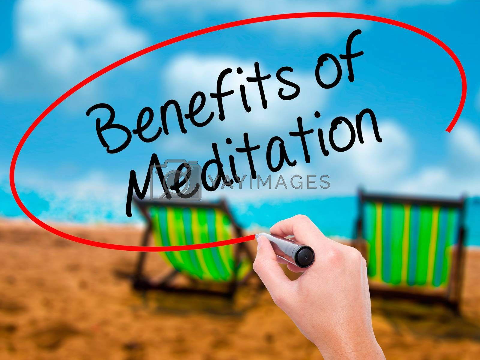Man Hand writing Benefits of Meditation with black marker on visual screen. Isolated on sunbed on the beach. Business, technology, internet concept. Stock Photo