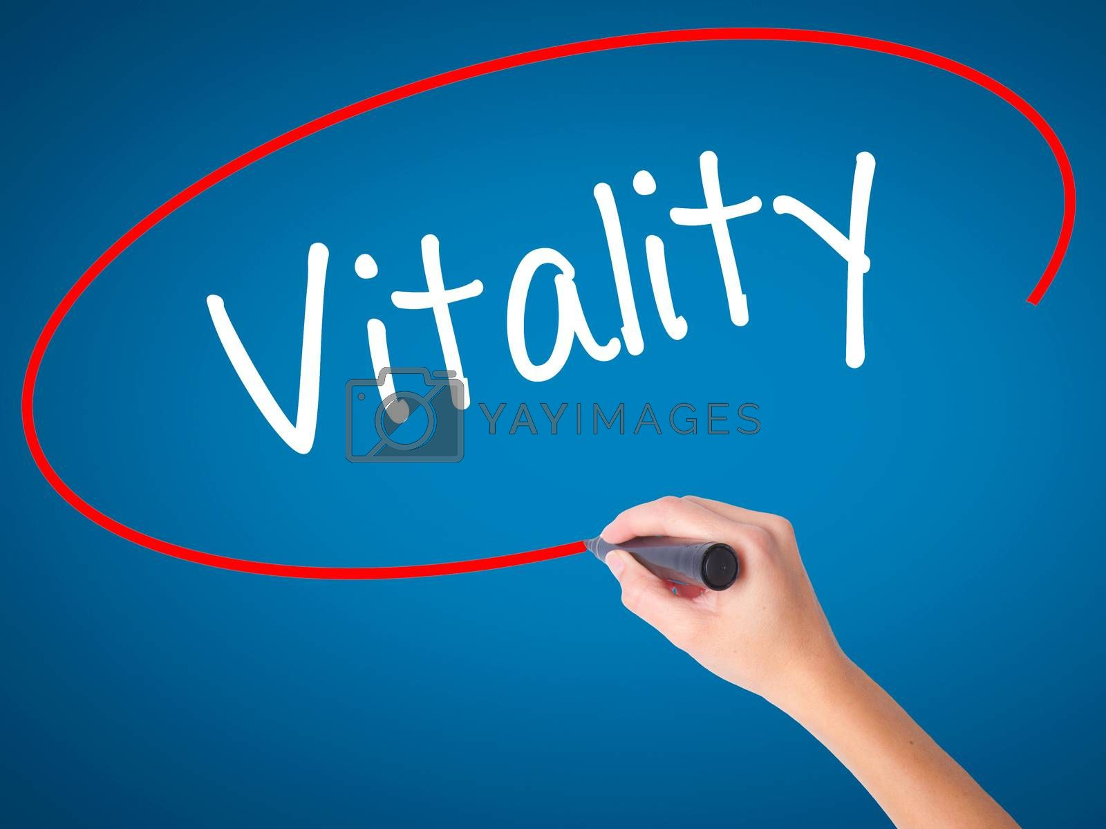 Women Hand writing Vitality  with black marker on visual screen. Isolated on blue. Business, technology, internet concept. Stock Photo