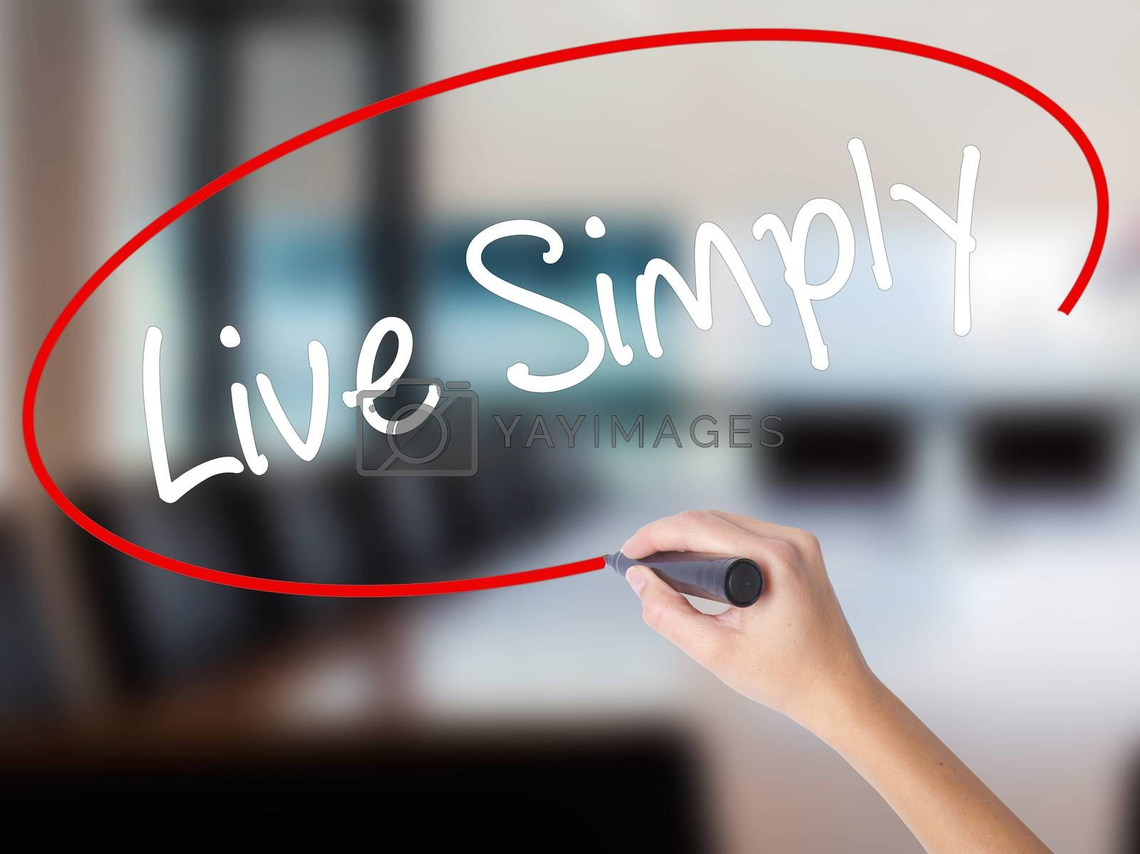 Woman Hand Writing Live Simply with a marker over transparent board. Isolated on Office. Business concept. Stock Photo