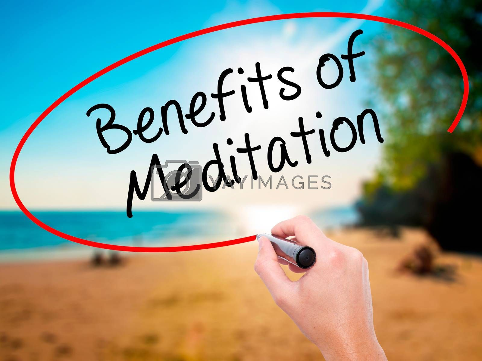 Man Hand writing Benefits of Meditation with black marker on visual screen. Isolated on background. Business, technology, internet concept. Stock Photo