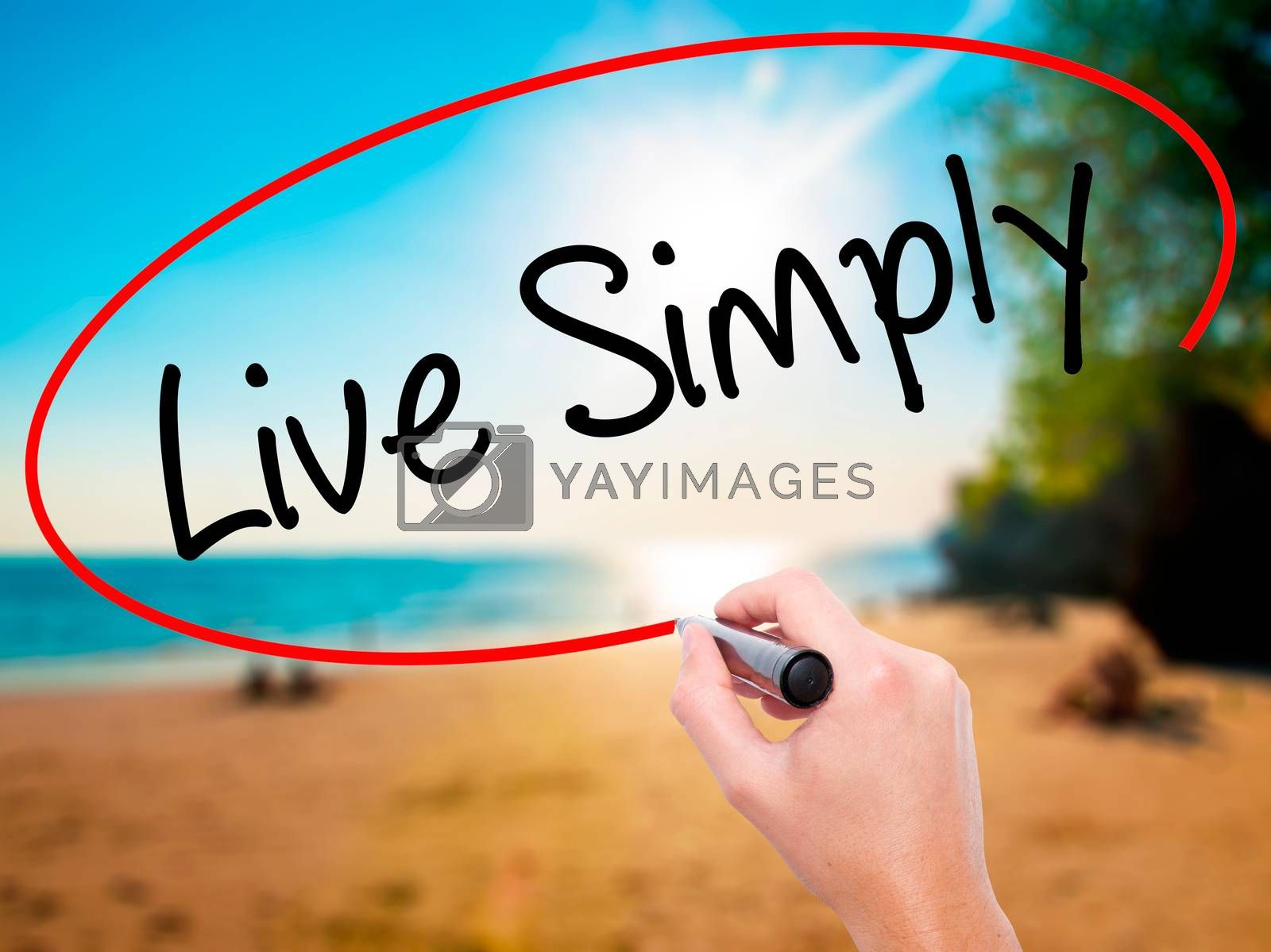 Man Hand writing Live Simply with black marker on visual screen. Isolated on background. Business, technology, internet concept. Stock Photo