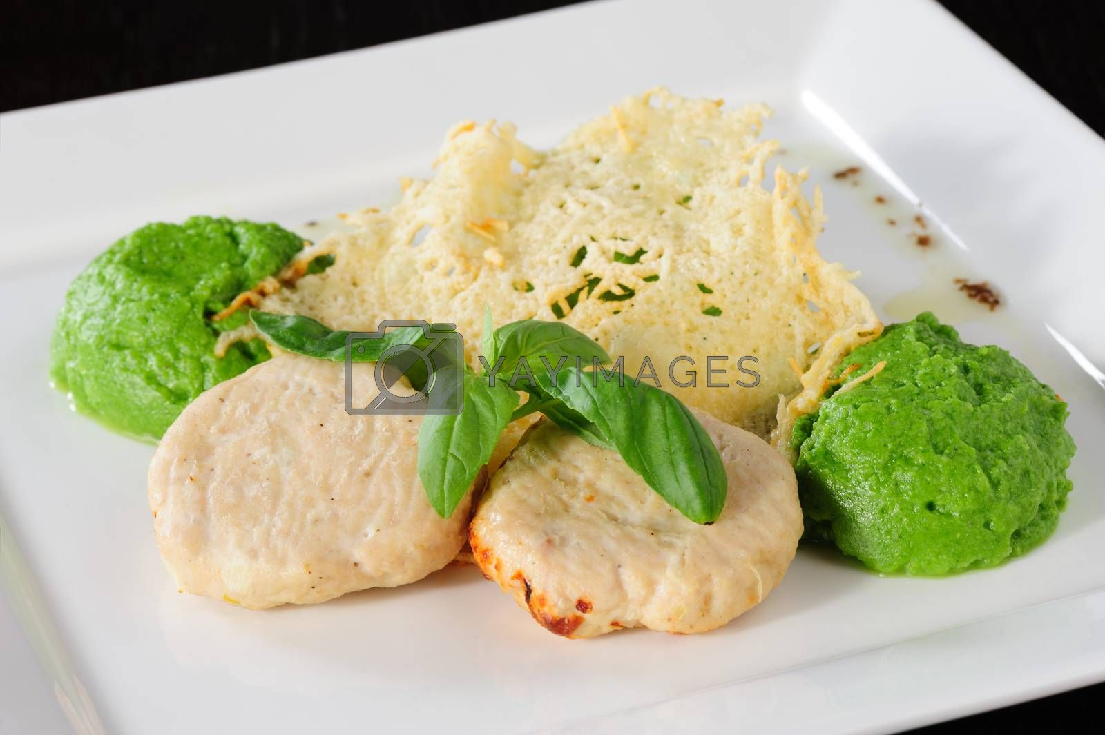 Steamed meatballs with green potato-broccoli puree and basil leaves
