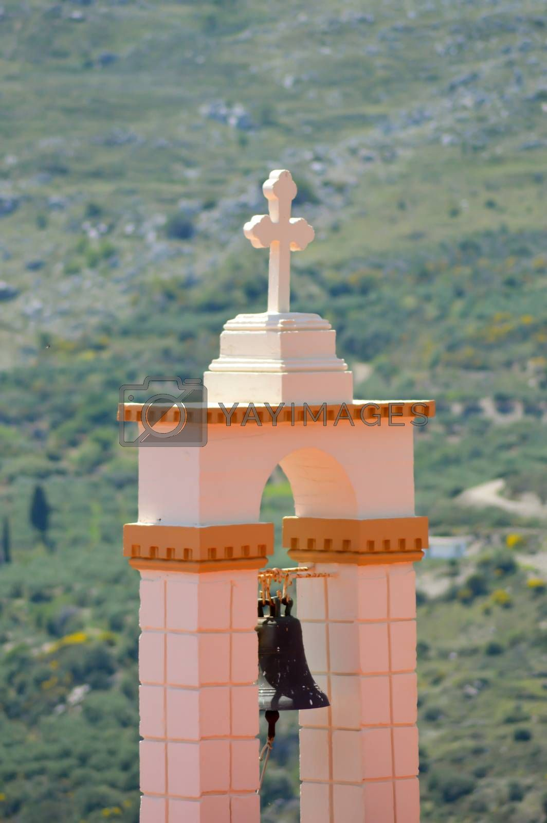 Outside bell of a Greek Orthodox church with the mountain in the background