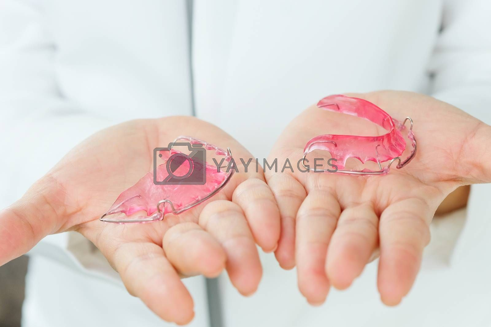 Dentist holding Retainer, Orthodontics Dental concept background