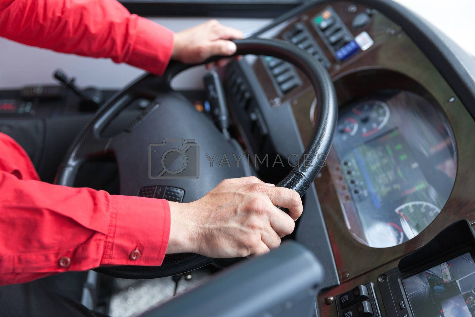 Hand close up of couch driver driving passenger bus