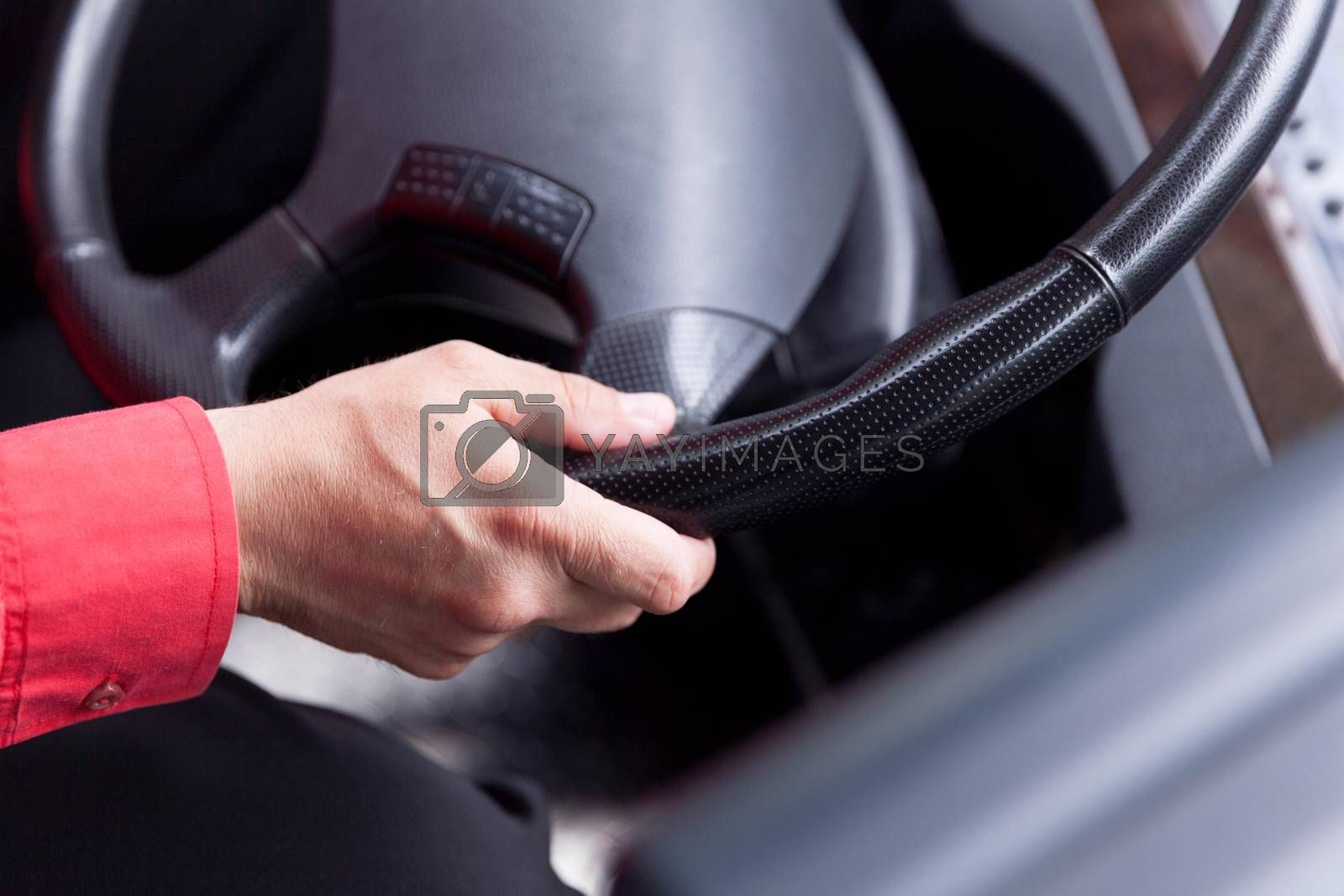 Hand close up of bus driver driving passenger bus