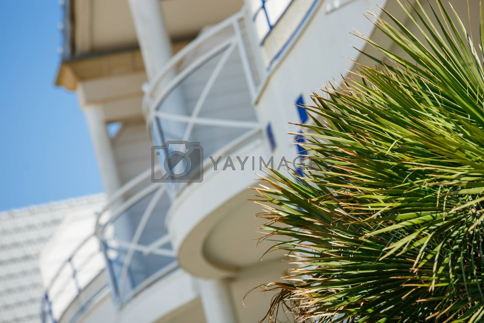 Royalty free image of Modern apartment buildings exteriors in sunny day by pixinoo