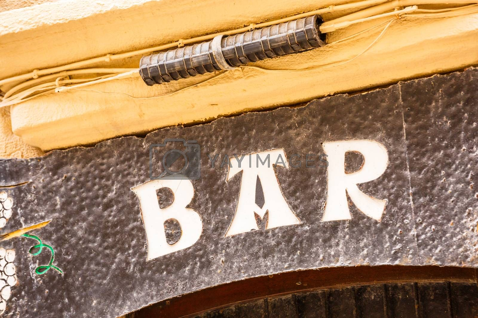 Royalty free image of an old bar sign over a dirty wall by pixinoo