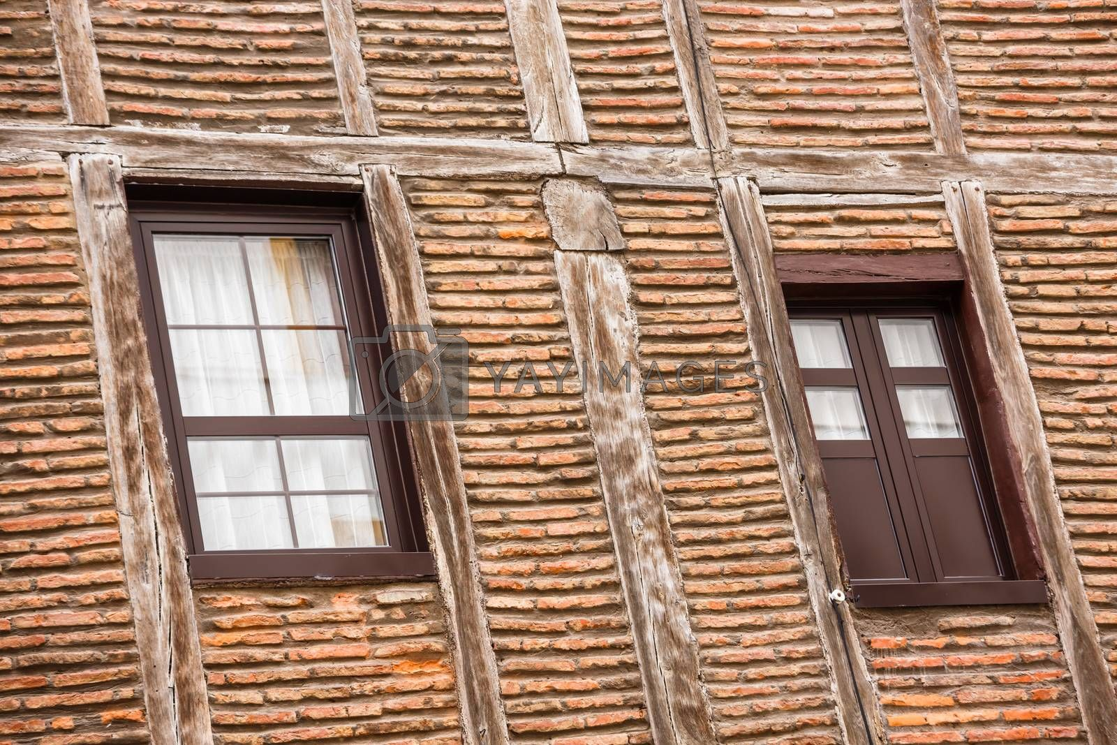 Royalty free image of Wall of the old house with the reflection in the windows by pixinoo