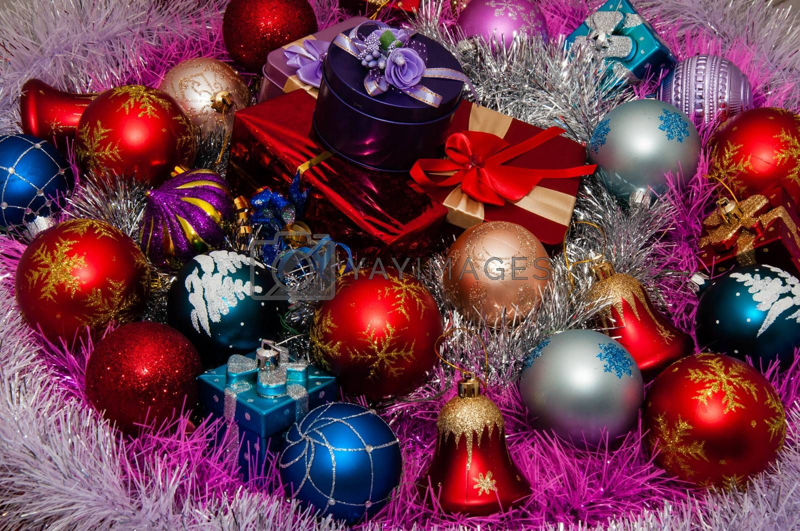 Colorful Christmas ornaments and boxes with Christmas gifts