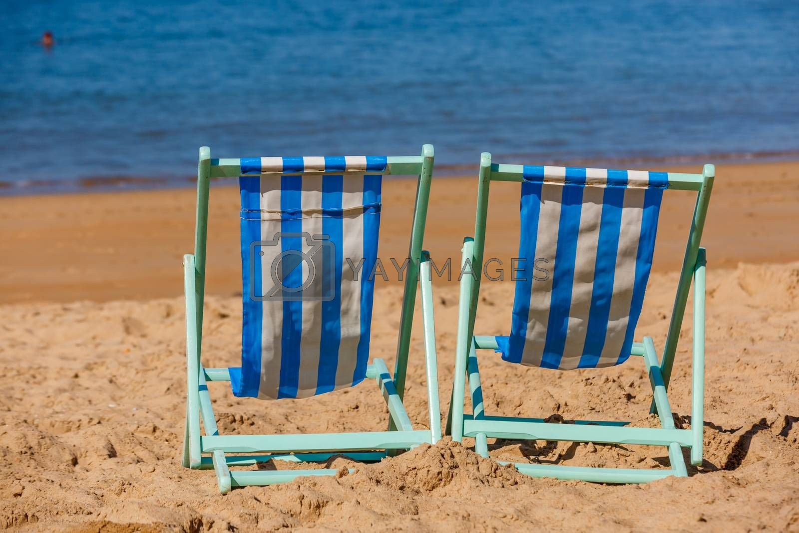 Royalty free image of Two empty deckchairs facing the sea by pixinoo
