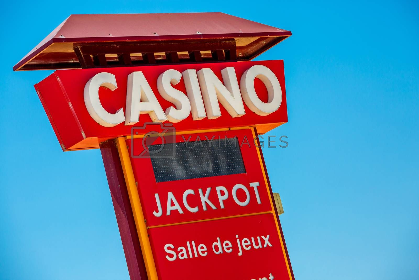 Royalty free image of Casino sign on blue sky background by pixinoo