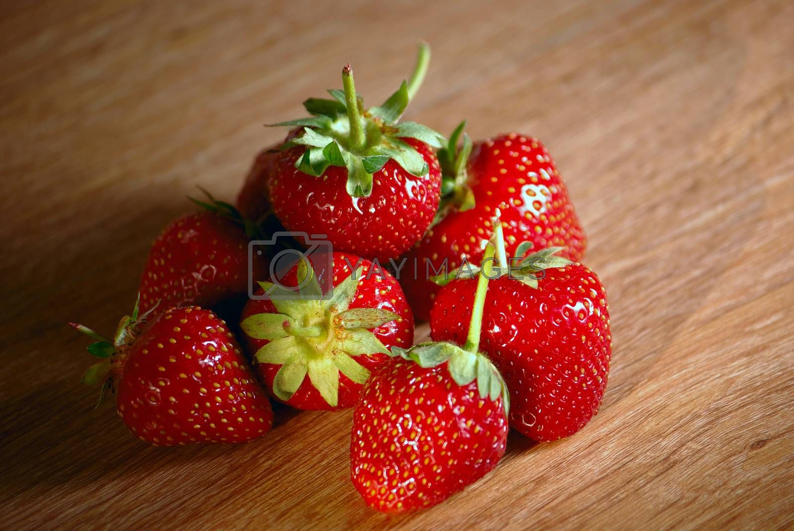 Fresh ripe red strawberries with leaves on the table