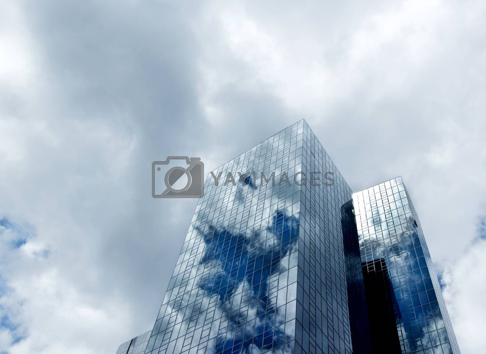 Modern Office Buildings with Mirror Facade and Sky Reflection against Clouds Outdoors. Bottom Up View