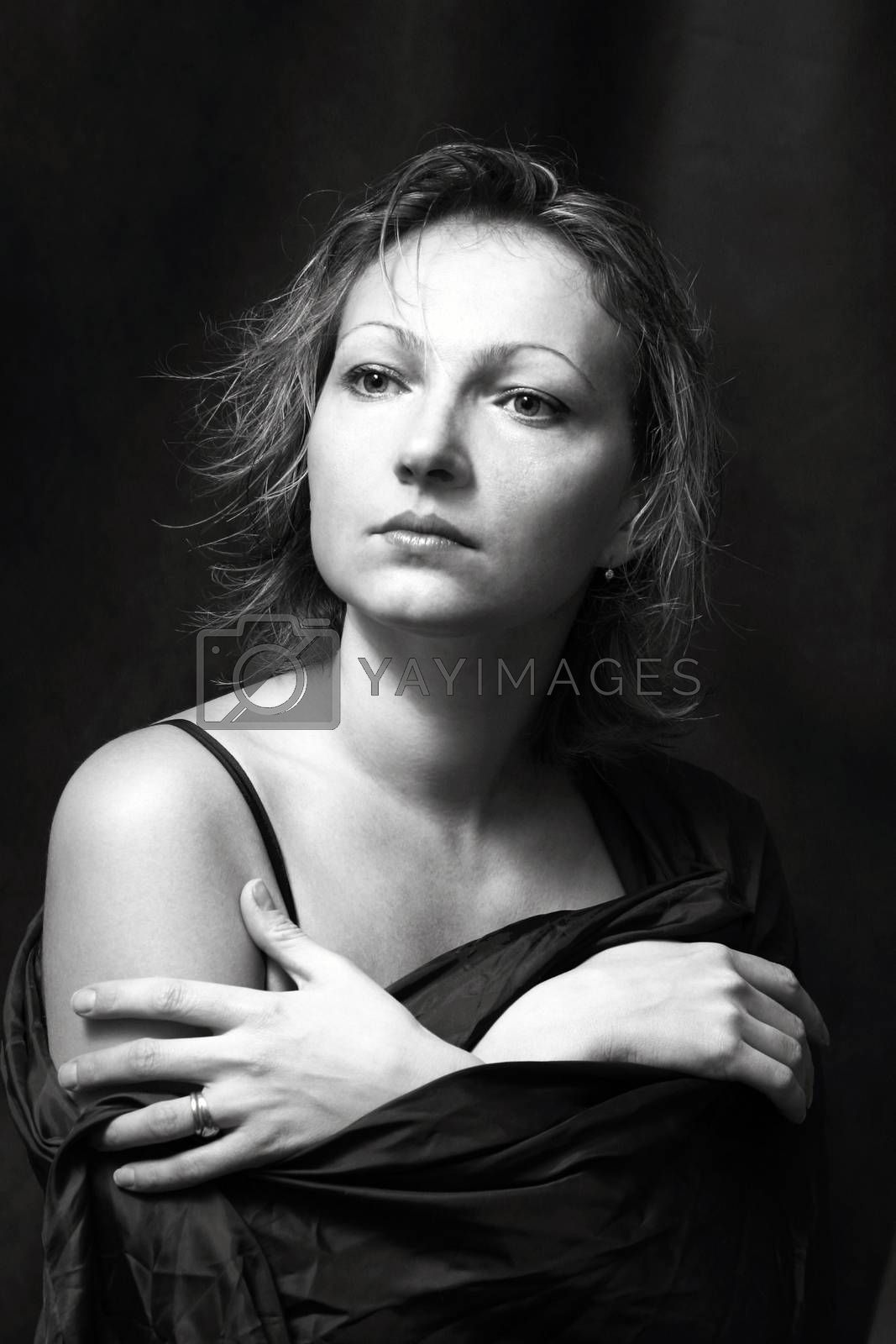 Portrait of the beautiful woman in studio