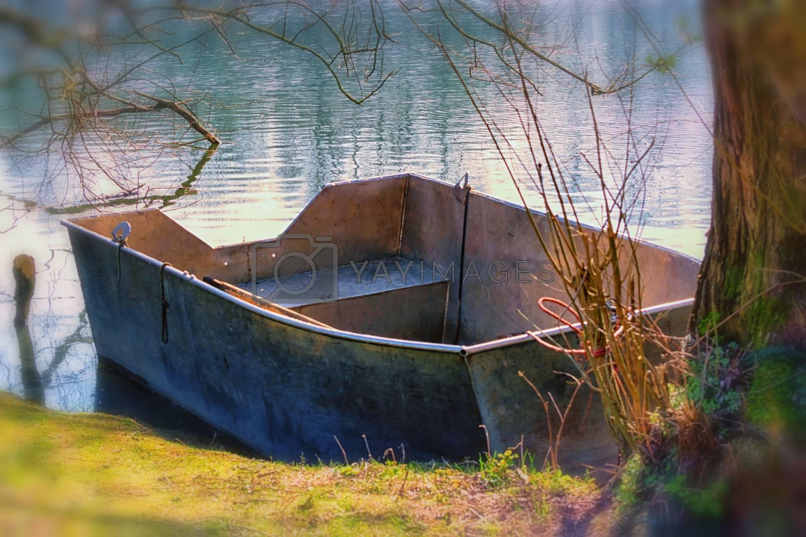Fishing boat, aluminum rowing boat on a lake.
