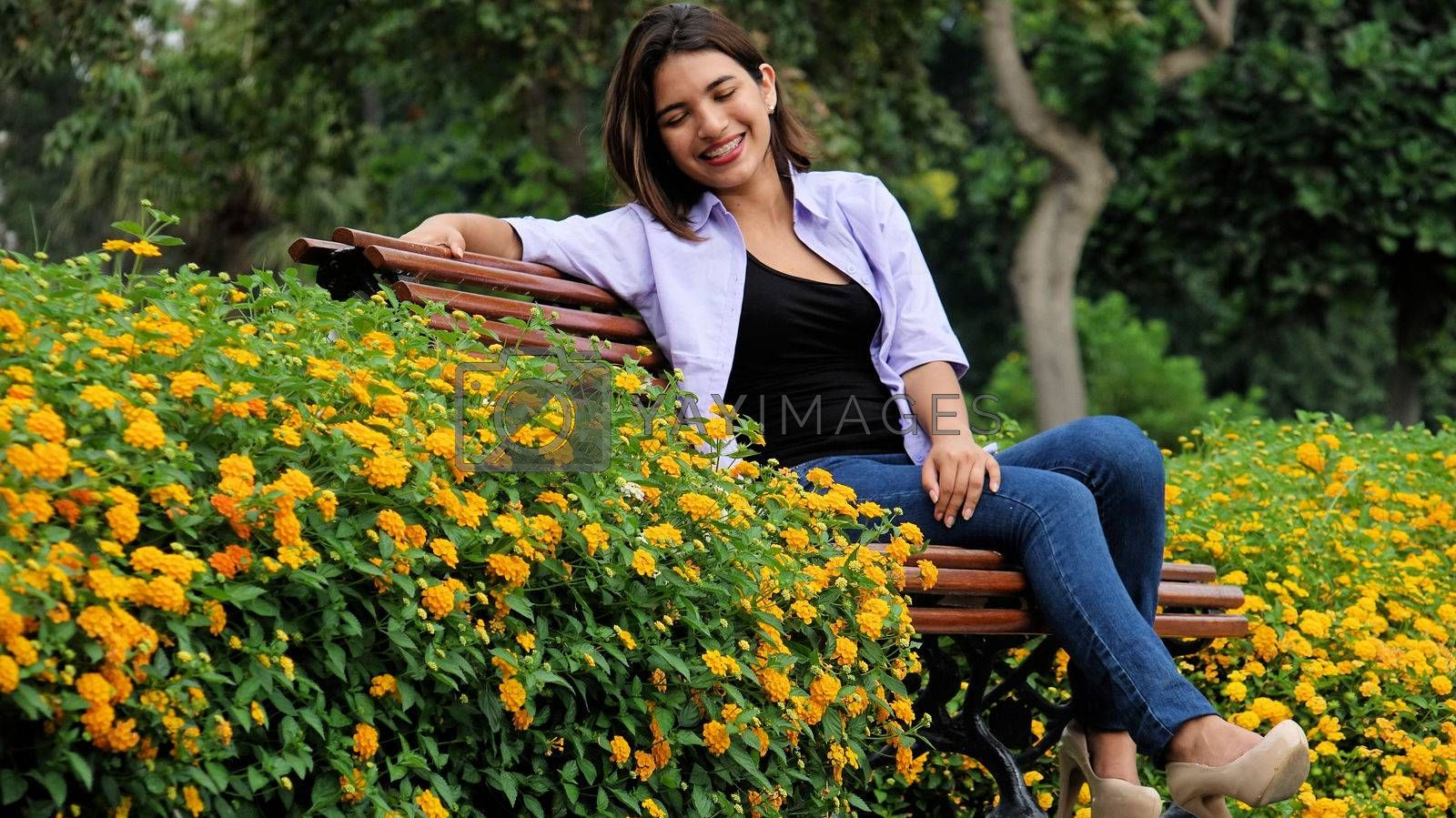 Young Girl And Happiness Sitting In Park