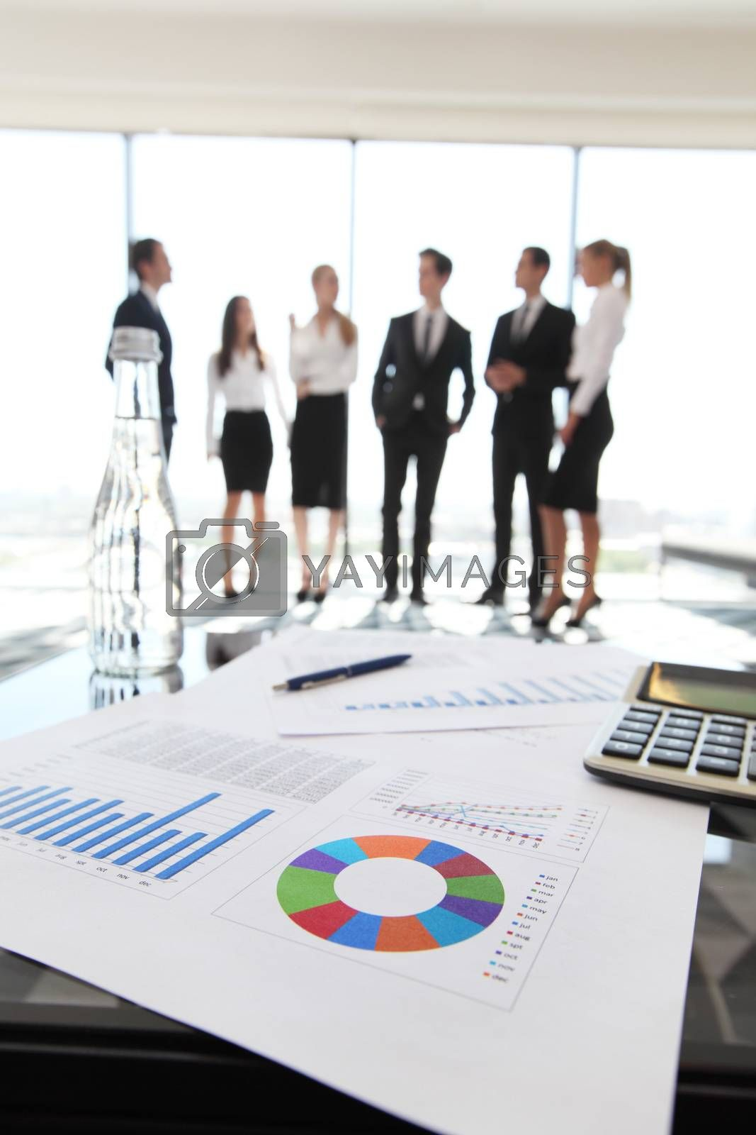 Financial data and business people by ALotOfPeople