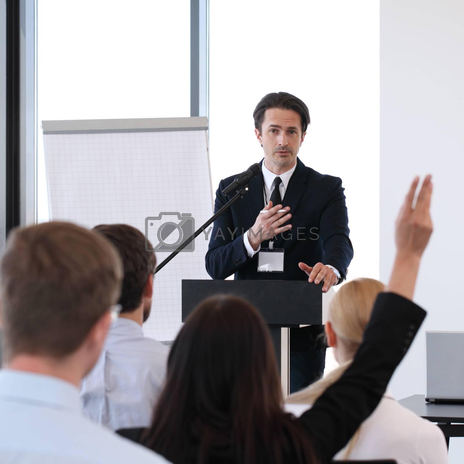 Speakers at business meeting by ALotOfPeople