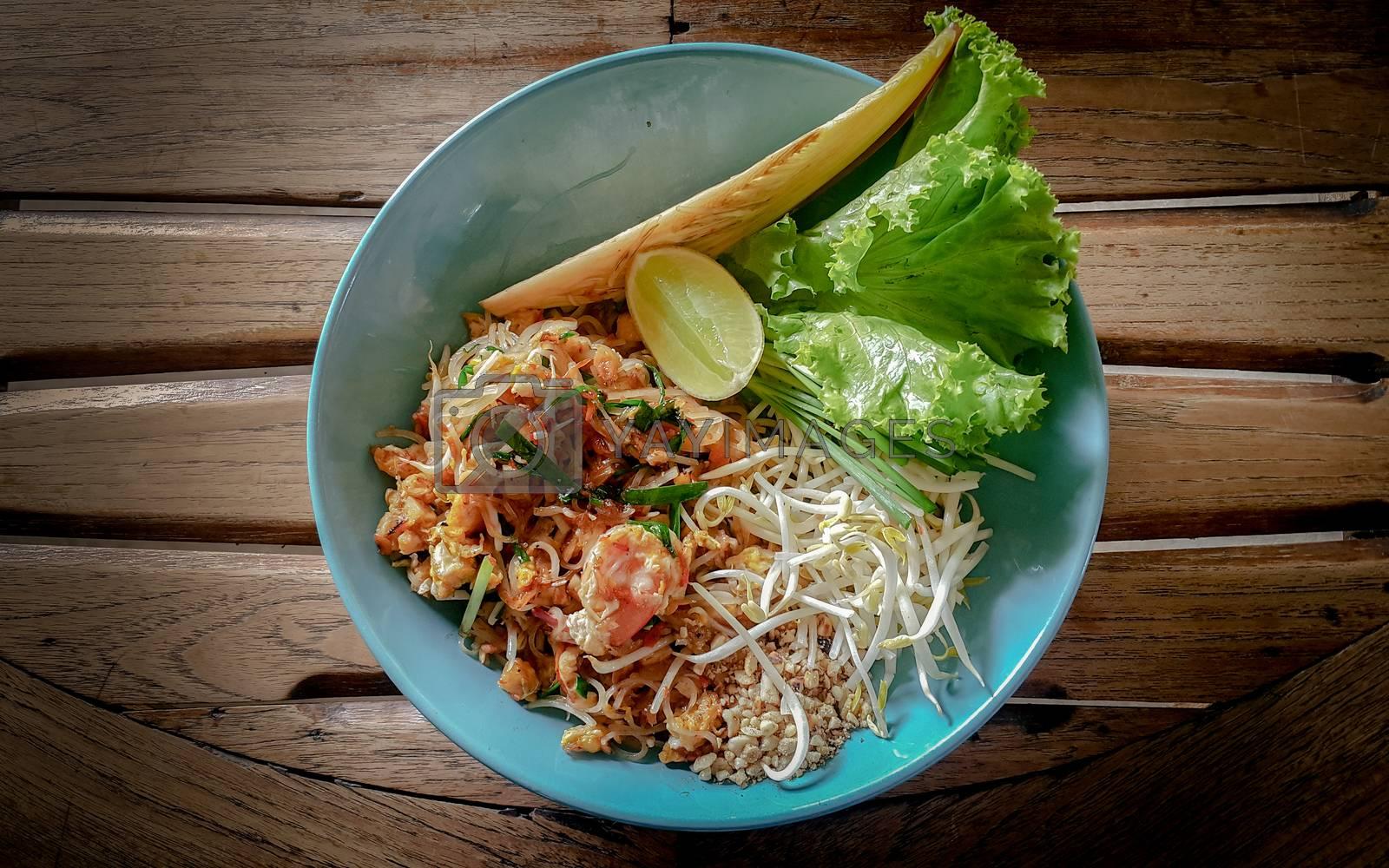 Thai food Pad thai on wood background. by gukgui